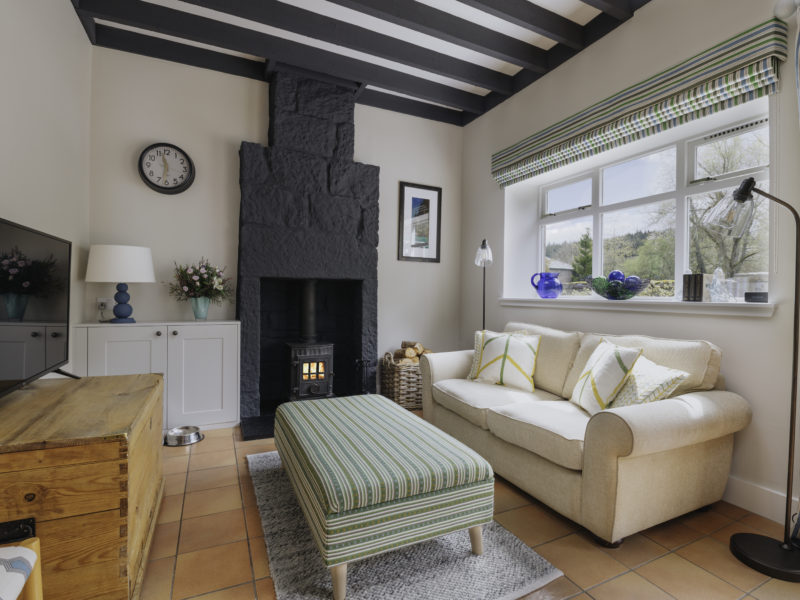 A cosy lounge with wood burning stove